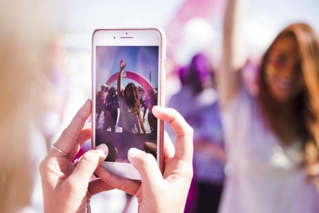 A Woman Use Prisma Photo Editing App Phone